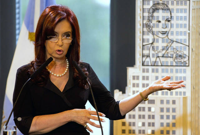 Argentina's President Cristina Fernandez talks to a group of Argentine governors at the government house in Buenos Aires, Argentina, Wednesday Dec. 28, 2011. Fernandez, who on Tuesday was diagnosed with treatable thyroid cancer, will undergo surgery on Jan. 4 and then take 20 days of medical leave, during which Vice President Amado Boudou will run the country. Next to Fernandez is a scale model of an iron sculpture of Argentina's former first lady and second wife of President Juan Peron, Eva Peron. (AP Photo/Eduardo Di Baia)
