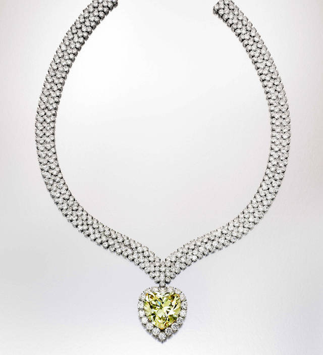 This undated photo provided by Sotheby's shows a heart-shape yellow diamond that once belonged to the Duchess of Windsor, who wore it in a ring before it was made into this necklace. It is among a trove of jewels from the collections of Estee and Evelyn Lauder that will be auctioned to benefit breast cancer research on Dec. 5. AP Photo/Sotheby's <strong> - AP</strong>