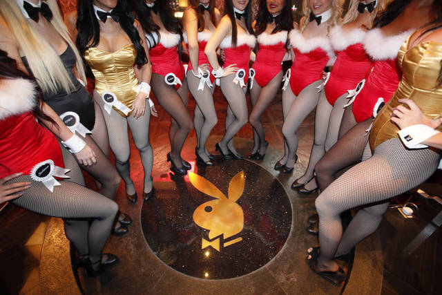 FILE - In this Dec. 18, 2010 file photo, waitresses pose inside the Playboy Club at the Sands Casino in Macau. After a month of heated debate, the government in the tourist hotspot of Goa in India on Monday, April 15, 2013 refused permission for promoters to open the country's first Playboy club in a 22,000-square-foot open-air property on upmarket Candolim beach. (AP Photo/Kin Cheung, File)
