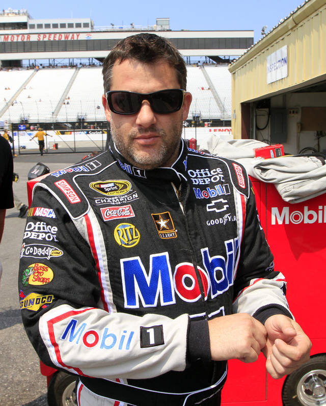 Driver Tony Stewart gets ready for practice for Sunday's NASCAR Sprint Cup series auto race Friday, July 13, 2012, at New Hampshire Motor Speedway in Loudon, N.H. (AP Photo/Jim Cole)
