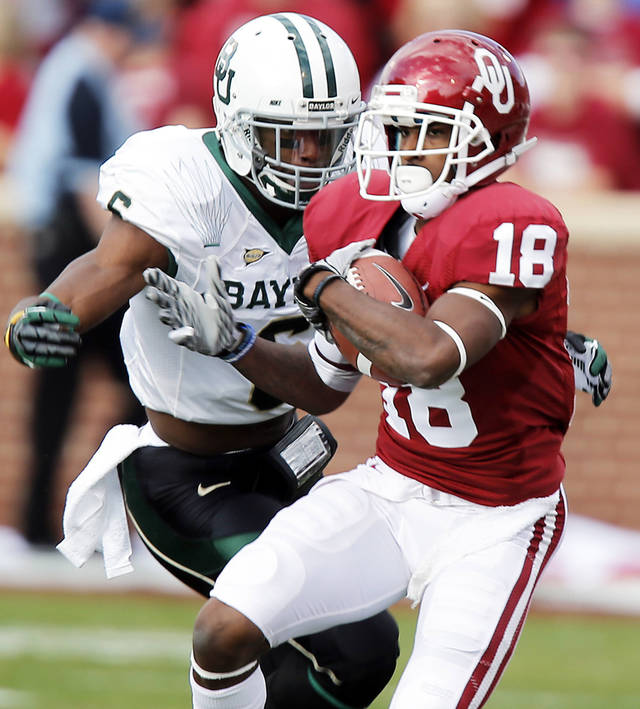 Baylor�s Ahmad Dixon, back, chases down Oklahoma�s Jalen Saunders earlier this season. Saunders was arrested early Sunday and was charged with misdemeanor marijuana possession.  Photo by Chris Landsberger, The Oklahoman