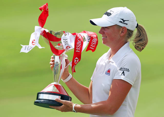 Stacy Lewis of the United States celebrates with the challenge trophy after winning the HSBC Women's Champions golf tournament on Sunday, March 3, 2013 in Singapore. (AP Photo/Wong Maye-E)