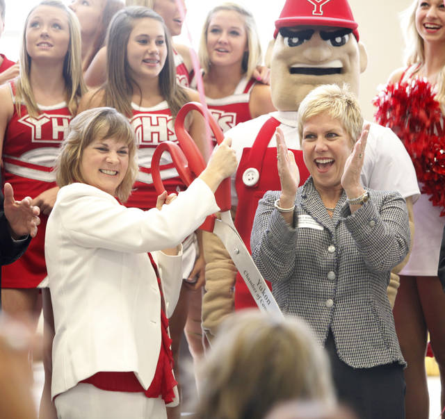 Yukon Board of Education President Karen Youngblood, left, and state schools Superintendent Janet Barresi celebrate Monday during the ribbon cutting for Yukon High School. Photo by Steve Gooch, The Oklahoman