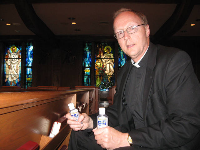 The Rev. Rick Stansberry, pastor of Christ the King Catholic Church, is shown at his Nichols Hills church in this archive photo.  <strong>CARLA HINTON - STAFF WRITER</strong>
