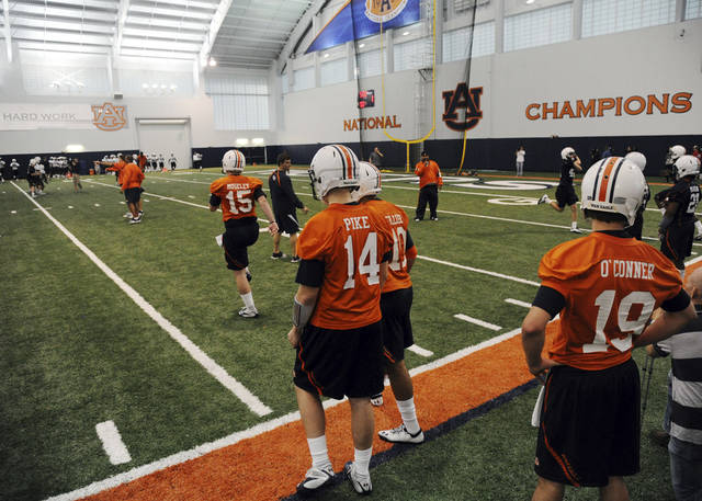 Auburn quarterbacks Clint Moseley (15), Kiehl Frazier (10), Zeke Pike (14) and Tate O'Connor (19) run through a drill during spring NCAA college football practice, Friday March 23, 2012 in Auburn, Ala. (AP Photo/The Birmingham News, Hal Yeager) MAGS OUT