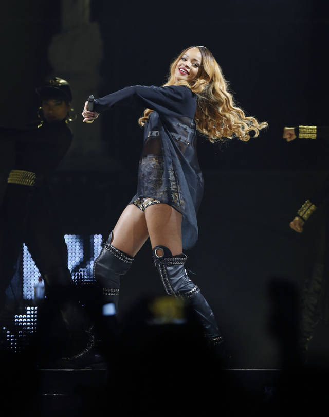 Rihanna performs in concert on Monday, May 6, 2013 in Boston. (Photo by Bizuayehu Tesfaye/Invision/AP) ORG XMIT: MABT103
