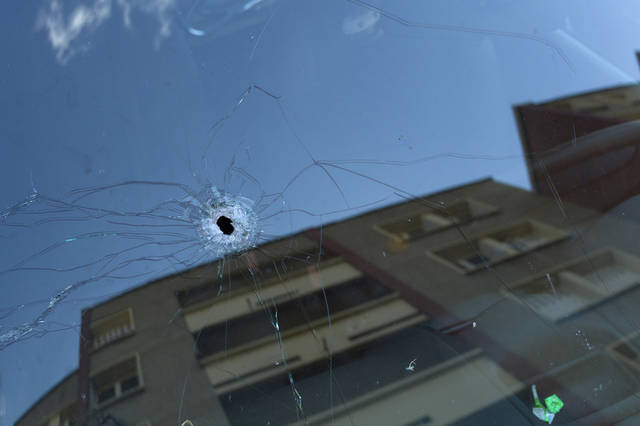 A bullet-hole is seen in a car windscreen in front of Mohamed Merah's apartment building, in Toulouse, Friday March 23, 2012. France's prime minister fended off suggestions Friday that anti-terrorism authorities fell down on the job in monitoring a radical Islamist who gunned down children, paratroopers and a rabbi in a wave of killings that revolted the country. Merah, who claimed allegiance to al-Qaida died Thursday during a gunfight with police following a 32-hour standoff outside his apartment in the southwestern city of Toulouse. (AP Photo/Thibault Camus)