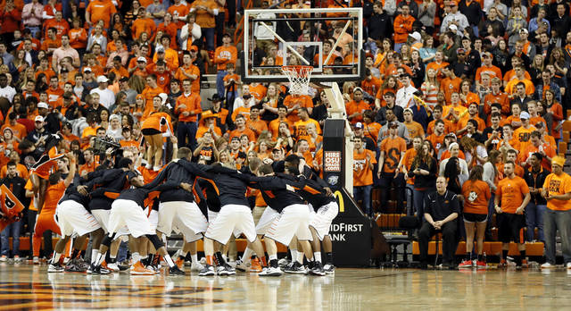 The OSU Cowboys huddle together before a men's college basketball game between Oklahoma State University and the University of Texas at Gallagher-Iba Arena in Stillwater, Okla., Saturday, March 2, 2013. Photo by Nate Billings, The Oklahoman