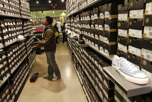 Eddy Caballeros, of Oklahoma City, looks at shoes at the Converse outlet during Black Friday at The Outlet Shoppes at Oklahoma City, Thursday, Nov. 24, 2011.  Photo by Garett Fisbeck, For The Oklahoman