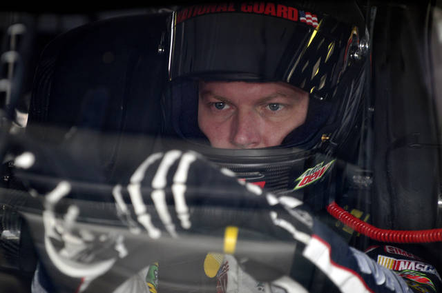 Dale Earnhardt Jr., looks on during practice for the NASCAR Sprint Cup Series auto race at Watkins Glen International in Watkins Glen, N.Y., Friday, Aug. 12, 2011. (AP Photo/Tom Ryder)