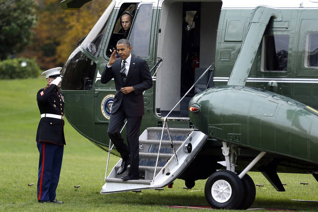 <p>President Barack Obama steps from Marine One helicopter as he returns to the White House in Washington, Thursday, Nov. 15, 2012, after visiting Superstorm Sandy affected areas in New York. (AP Photo/Jacquelyn Martin)</p>