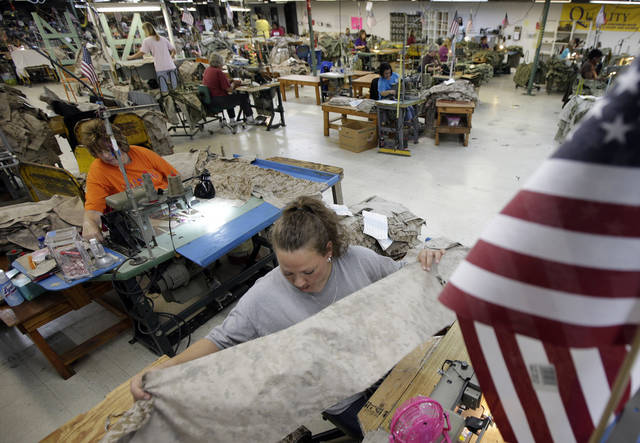In this Wednesday, Oct. 10, 2012 photo, apparel worker Misti Keeton sews military apparel in Fayette, Ala. Her employer, American Power Source, is laying off about 50 workers at her plant and another one in Columbus, Miss., after losing a contract to make Air Force exercise garb to Unicor. �I�m terrified,� Keeton said. �I�ve got two teenagers at home. I don�t know what I�m supposed to say to them if I lose this job. I don�t know what I�m supposed to feed them.� (AP Photo/Dave Martin)