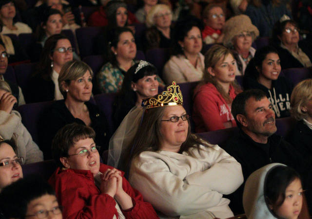 "FILE - In this April 29, 2011, file photo, Sandy Weimer, wearing tiara, and Cathy Dettman, left, attend a royal wedding ""hat and pajamas"" party at the Cameo Cinema in St. Helena, Calif., where more than150 people filled the theater in the middle of the night to watch a live broadcast of the royal wedding of Britain's Prince William and Kate Middleton. The palace announced Monday, Dec. 3, 2012, that Prince William and wife Kate are expecting their first child_and it seems at times that Americans may be more enthralled than the Brits. There are several reasons for the American public�s pleasure in Kate�s news, manifested not only by the good wishes sent by President Obama but also by the breathless news coverage and the general good will toward the couple. (AP Photo/Eric Risberg, File)"