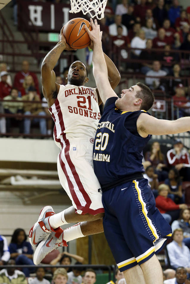 Oklahoma's Cameron Clark (21) is guarded by Jacob Strassle (20) as the University of Oklahoma (OU) Sooners men's basketball team plays the Central Oklahoma Bronchos at McCasland Field House on Wednesday, Nov. 7, 2012  in Norman, Okla. Photo by Steve Sisney, The Oklahoman