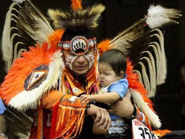 James Shawnee, Jr. is fascinated with the colorful beadwork on the costume of his uncle, George Alexander, while Alexander entertains his nephew while waiting to perform in fancy dance competition at the 2012 Red Earth Festival inside the Cox Convention Center on Saturday, June 9, 2012. Alexander is a member of the Otoe/Iowa tribes and he lives in Ponca City. Photo by Jim Beckel, The Oklahoman