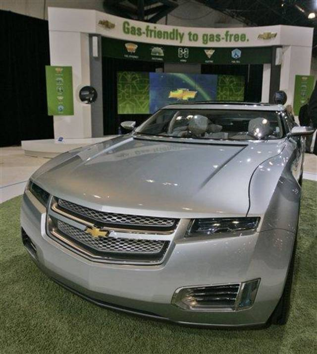 FILE - In this March 19,2008 file photo, a Chevy Volt is on display during the Chevrolet  news conference at the New York International Auto Show in New York. President Barack Obama's promise to put a million plug-in hybrid cars on the road by 2015 is fraught with problems, from engineering hurdles to the realities of the auto market and the economy. (AP Photo/Mary Altaffer, FILE)