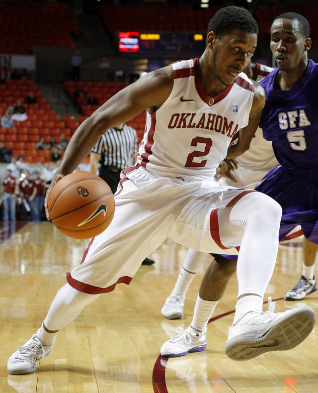 Oklahoma's Steven Pledger (2) drives past Stephen F. Austin's Antonio Bostic (5) during a college basketball game between the University of Oklahoma (OU) and Stephen F. Austin University at the Lloyd Noble Center in Norman, Okla., Tuesday, Dec. 18, 2012. Oklahoma lost 56-55. Photo by Bryan Terry, The Oklahoman