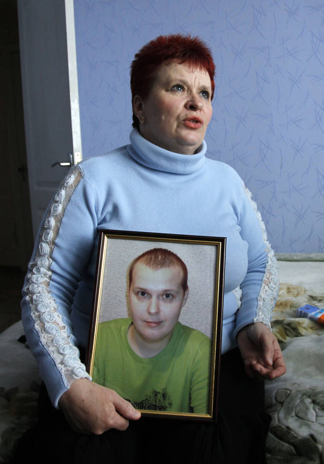 Nadezhda Zhukovsky, 50, holds a photograph of her son Vlad, who died of brain cancer last year at age 27, in Cherkasy, Ukraine, Thursday May 5, 2011. Hundreds of thousands of Ukrainians who suffer from terminal illnesses or chronic pain are denied proper pain relief and palliative care, Human Rights Watch said in a report Thursday, May 12, 2011, urging Ukrainian authorities to adopt international guidelines for pain management and end the patients' needless suffering. (AP Photo/Efrem Lukatsky)
