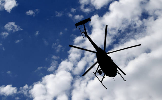 An Oklahoma City Police Department helicopter does a fly-by on May 18 during the Oklahoma Law Enforcement Officers Memorial Service in Oklahoma City. The department's two choppers have been grounded for maintenance work, police said this week. Photo by Steve Gooch, The Oklahoman Archive <strong>Steve Gooch - The Oklahoman</strong>