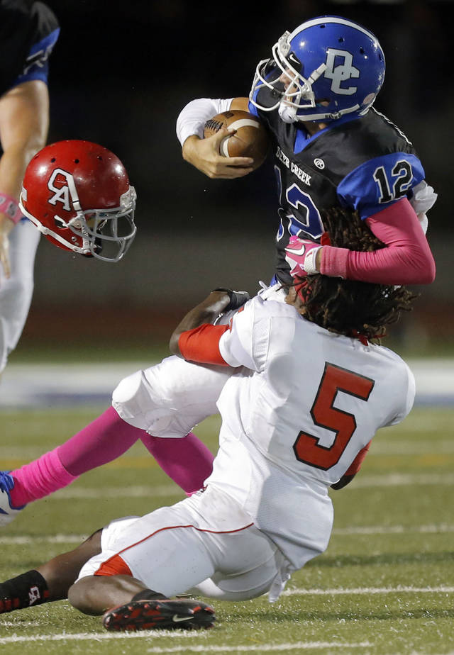 Carl Albert's Bryan Williams tackles Deer Creek's Joel Blumenthal during the high school football game between Deer Creek and Carl Albert at Deer Creek High School, Friday, Sept. 21, 2012.  Photo by Sarah Phipps, The Oklahoman