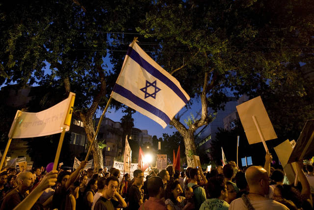 Israeli activists gather during a protest against the rising living prices, in central Tel Aviv, Israel, Thursday, Aug. 4, 2011. About 2,000 Israelis participated in the Tel Aviv march, protesting the overall high prices in Israel. (AP Photo/Ariel Schalit)