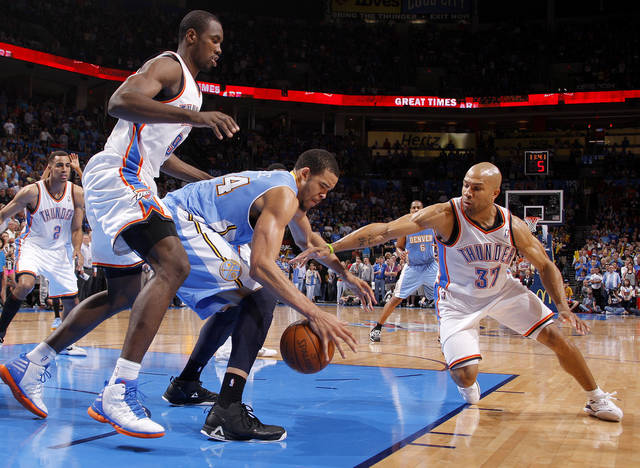 Oklahoma City's Serge Ibaka (9) and Oklahoma City's Derek Fisher (37) defend Denver's JaVale McGee (34) during the NBA basketball game between the Oklahoma City Thunder and the Denver Nuggets at Chesapeake Energy Arena in Oklahoma City, Wednesday, April 25, 2012. Oklahoma City lost 106-101.  Photo by Bryan Terry, The Oklahoman