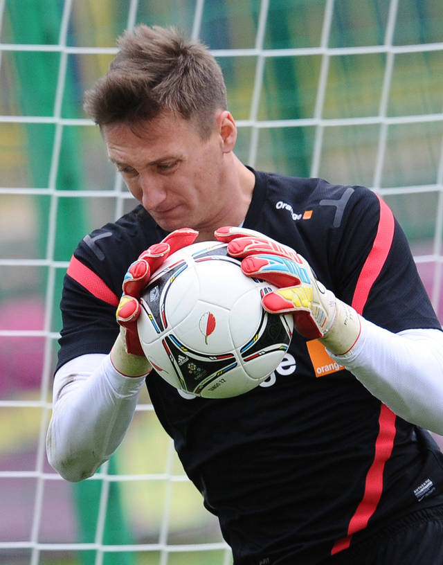 Poland's goalkeeper Przemyslaw Tyton saves the ball during a training session of Poland at the soccer Euro 2012 championship in Warsaw, Poland, Sunday, June 10, 2012. (AP Photo/Alik Keplicz)