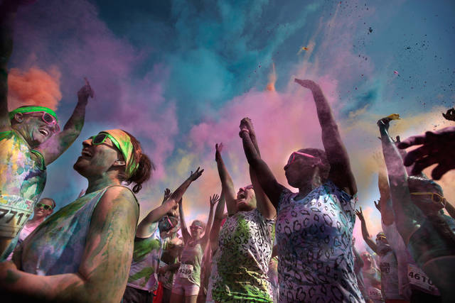Runners celebrate the finish of  the Color Me Rad 5K at the State Fair Park in Oklahoma City, Saturday, July 14, 2012. The race helped raised money for the Cystic Fibrosis Foundation. Photo by Sarah Phipps, The Oklahoman. ORG XMIT: OKOKL