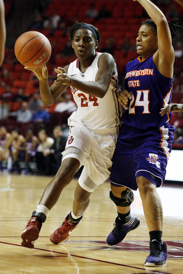 Oklahoma Sooners' Sharane Campbell (24) passes as she is guarded by Northwestern State Lady Demons' Jasmine Bradley (24) during the second half as the University of Oklahoma (OU) Sooner women's basketball team plays the Northwestern State Lady Demons at the Lloyd Noble Center on Thursday, Nov. 29, 2012  in Norman, Okla. Photo by Steve Sisney, The Oklahoman