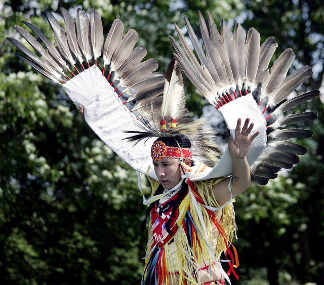 Joseph Bearstail. a member of the Sioux tribe, wears a costume with eagle feathers while performing a traditional dance in 2006.  AP file photo