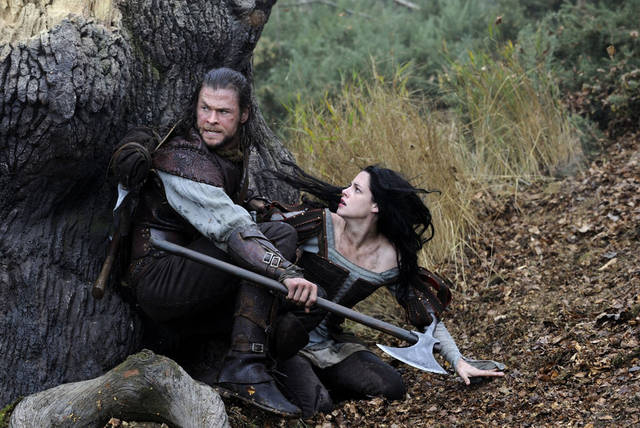Chris Hemsworth stars as the Huntsman and Kristen Stewart as Snow White in �Snow White and the Huntsman.� UNIVERSAL PICTURES PHOTO