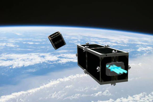 "In this illustration provided by the Swiss Space Center of the Swiss Federal Institute of Technology (EPFL) on Wednesday, February 15, 2012, the CleanSpace One is chasing its target, one of the CubeSats launched by Switzerland in 2009. The EPFL on Wednesday launched the ""CleanSpace One"", a project to develop and build the first installment of a family of satellites specially designed to clean up space debris, during a press conference in Lausanne, Switzerland, Wednesday, February 15, 2012. (AP Photo/HO/T EPFL/Swiss Space Center) Mandatory Credit - NO SALES"