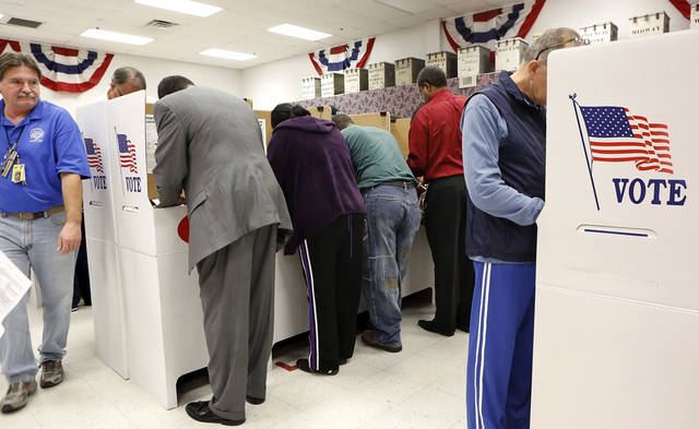 Early voters crowd into booth spaces inside the Oklahoma County Election Board on N. Lincoln Blvd,  Monday afternoon, Nov. 5, 2012.    Photo by Jim Beckel, The Oklahoman