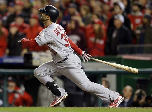 St. Louis Cardinals' Daniel Descalso watches his solo home run in the eighth inning of Game 5 of the National League division baseball series against the Washington Nationals on Friday, Oct. 12, 2012, in Washington. (AP Photo/Pablo Martinez Monsivais)