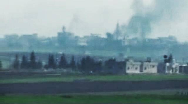 This image made from amateur video and released by Shaam News Network Monday, April 2, 2012, purports to show smoke rising from buildings in Idlib, Syria. The Syrian government has sent troops backed by tanks into rebellious areas, hunting down activists and torching their homes and bulldozing others, opposition groups said. (AP Photo/Shaam News Network via APTN) THE ASSOCIATED PRESS CANNOT INDEPENDENTLY VERIFY THE CONTENT, DATE, LOCATION OR AUTHENTICITY OF THIS MATERIAL. TV OUT