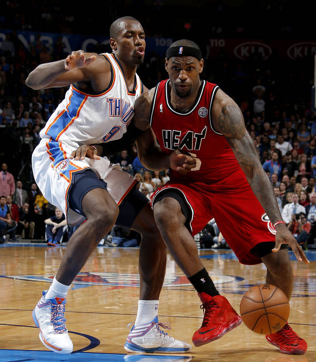 Miami's LeBron James (6) goes past Oklahoma City's Serge Ibaka (9) during an NBA basketball game between the Oklahoma City Thunder and the Miami Heat at Chesapeake Energy Arena in Oklahoma City, Thursday, Feb. 15, 2013. Miami won 110-100. Photo by Bryan Terry, The Oklahoman