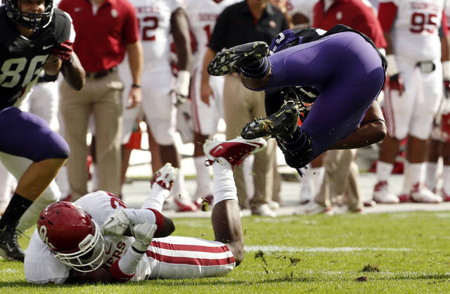 Oklahoma's Javon Harris (30) upends TCU's B.J. Catalon (23) during the college football game between the University of Oklahoma Sooners (OU) and the Texas Christian University Horned Frogs (TCU) at Amon G. Carter Stadium in Fort Worth, Texas, on Saturday, Dec. 1, 2012. Photo by Steve Sisney, The Oklahoman