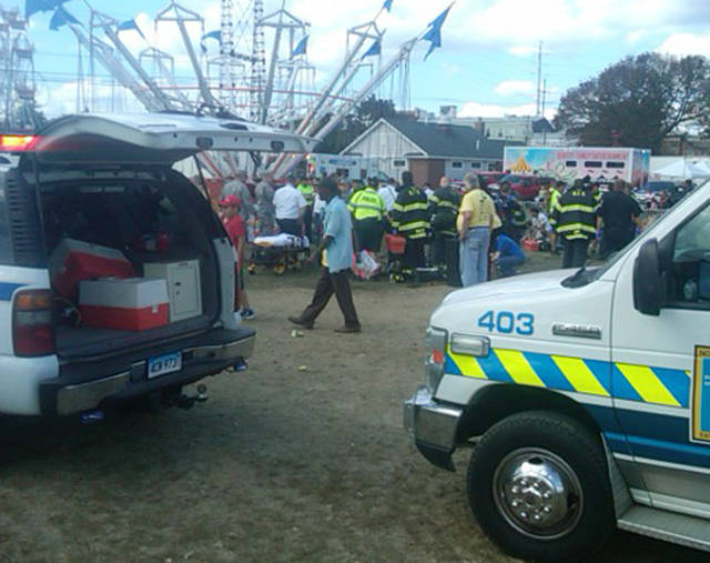 An amusement park ride malfunctioned Sunday Sept. 8, 2013 at the Norwalk Oyster Festival.  Thirteen children were injured when a festival attraction that swings riders into the air lost power at a community fair in Connecticut but none of the injuries appeared to be life-threatening, authorities said. Most of the children suffered minor injuries and were treated at the Oyster Festival in Norwalk, police said. Norwalk Police Chief Thomas Kulhawik said there were initial reports of serious injuries but preliminary indications are that the injuries were not as severe as first feared. (AP Photo/ The Advocate, David Wells)