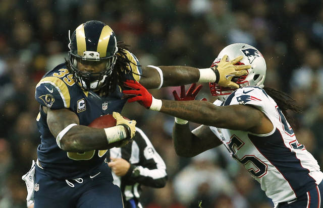 St. Louis Rams running back Steven Jackson, left, is caught by New England Patriots middle linebacker Brandon Spikes, during the first half of a NFL football game at Wembley Stadium, London, Sunday, Oct. 28, 2012. (AP Photo/Matt Dunham)