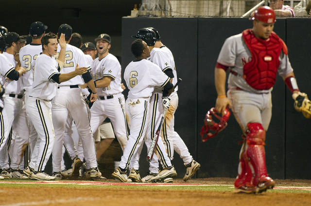 CORRECTS INNING, AND WHO SCORED - Vanderbilt players celebrate the Conrad Gregor's tying run, with North Carolina State catcher Danny Canela nearby, during the eighth inning of an NCAA college baseball tournament regional game in Raleigh, N.C., Saturday, June 2, 2012. Vanderbilt won 9-8.(AP Photo/Karl B DeBlaker)