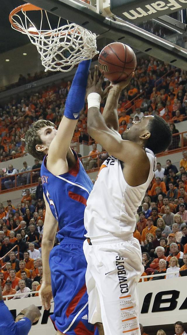 Kansas' Jeff Withey (5) defends on Oklahoma State 's Brian Williams (4) during the college basketball game between the Oklahoma State University Cowboys (OSU) and the University of Kanas Jayhawks (KU) at Gallagher-Iba Arena on Wednesday, Feb. 20, 2013, in Stillwater, Okla. Photo by Chris Landsberger, The Oklahoman