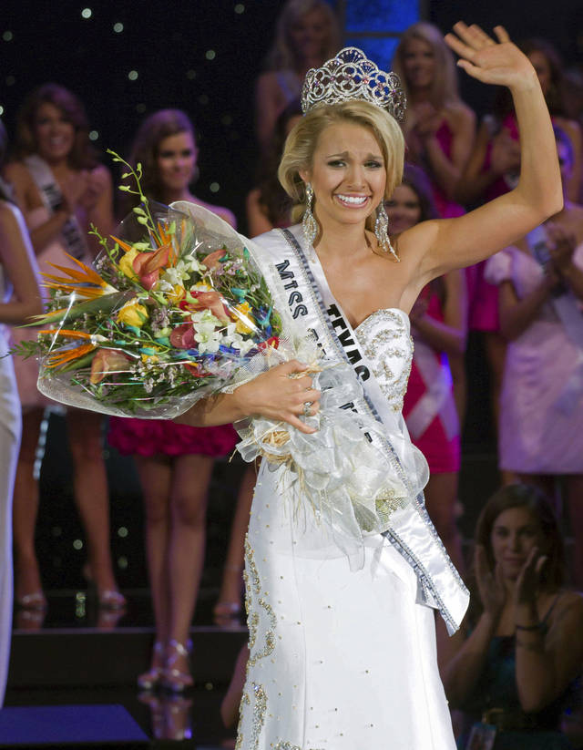 Miss Teen USA 2011 Danielle Doty, 18, of Harlingen, Texas, waves to the crowd as she takes her first walk after being crowned during the beauty pageant on Saturday July 16, 2011 in Nassau, Bahamas. (AP Photo/Tim Aylen)