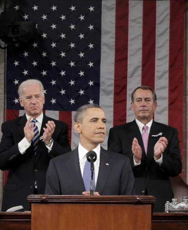 President Barack Obama is applauded by House Speaker John Boehner of Ohio and Vice President Joe Biden while delivering his State of the Union address on Capitol Hill in Washington, Tuesday, Jan. 25, 2011. (AP Photo/Pablo Martinez Monsivais, Pool)