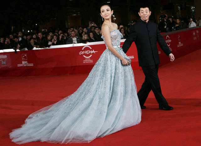 "Chinese actress Zhang Ziyi and director Gu Changwei, right, pose on the red carpet to present the movie ""Love for Life"" (Zuì ài) at the 6th Rome International Film Festival in Rome, Wednesday, Nov. 2, 2011. (AP Photo/Riccardo De Luca)"