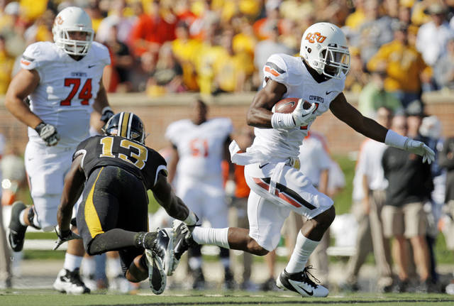 Oklahoma State's Joseph Randle (1) breaks away from Missouri's Kenji Jackson (13) in front of Oklahoma State's Grant Garner (74) in the first quarter during a college football game between the Oklahoma State University Cowboys (OSU) and the University of Missouri Tigers (Mizzou) at Faurot Field in Columbia, Mo., Saturday, Oct. 22, 2011. Photo by Nate Billings, The Oklahoman