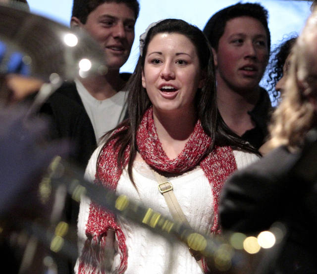 Emily Cole, Lexington freshman, sings with the Singing Sooners during the University of Oklahoma's (OU) Holiday Lighting Celebration on Wednesday, Nov. 28, 2012, in Norman, Okla.  