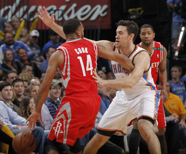 Oklahoma City 's Nick Collison (4) defends on Houston's Daequan Cook (14) during the NBA basketball game between the Houston Rockets and the Oklahoma City Thunder at the Chesapeake Energy Arena on Wednesday, Nov. 28, 2012, in Oklahoma City, Okla.   Photo by Chris Landsberger, The Oklahoman