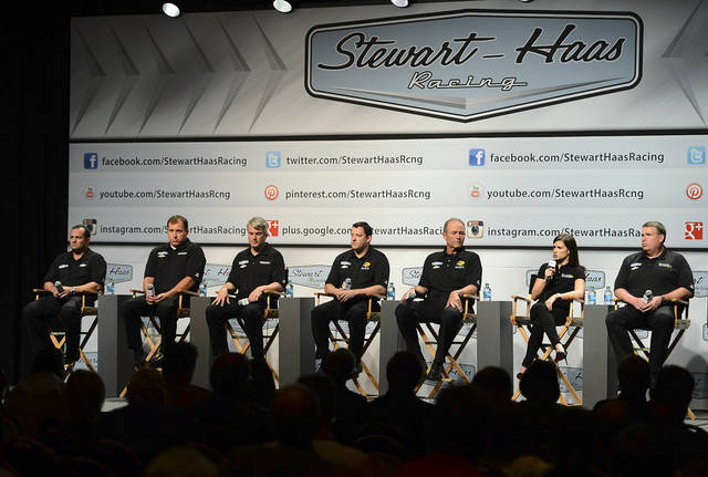 From left, Stewart-Haas Racing competition director Greg Zipadelli, driver Ryan Newman, crew chief Matt Borland, driver/owner Tony Stewart, crew chief Steve Addington, driver Danica Patrick and crew chief Tony Gibson attend a session during the NASCAR Media Tour, Monday, Jan. 21, 2013, in Concord, N.C. (AP Photo/The Charlotte Observer, Jeff Siner) MAGS OUT  TV OUT