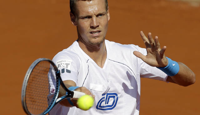 Czech Republic's Tomas Berdych returns the ball during a practice session ahead of the Davis Cup tennis semifinals against Argentina in Buenos Aires, Argentina, Wednesday, Sept. 12, 2012. (AP Photo/Natacha Pisarenko)