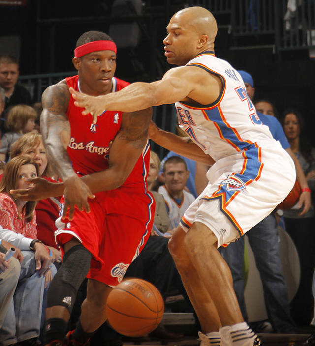 Oklahoma City Thunder Derek Fisher defends on Los Angeles Clippers point guard Eric Bledsoe (12) during the NBA basketball game between the Oklahoma City Thunder and the Los Angeles Clippers at Chesapeake Energy Arena on Wednesday, March 21, 2012 in Oklahoma City, Okla.  Photo by Chris Landsberger, The Oklahoman